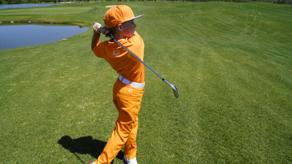 junior golfer taking a swing
